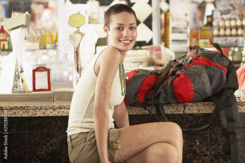 Female hiker sitting in bar, portrait