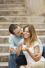 Couple sitting on steps Eating Gelato, front view