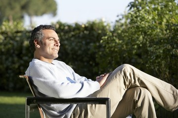 Man Relaxing in Garden