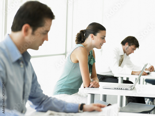 Businesswoman with laptop at desk