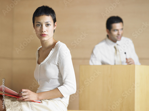 Businesswoman holding files during presentation, portrait