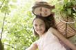 Two girl in backyard, portrait