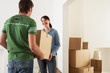 Couple Moving into New Home, carrying box