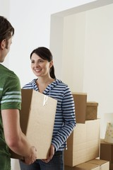 Young Couple Moving into New Home