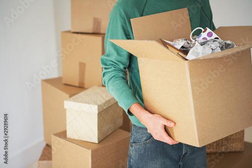 Man Carrying open Cardboard Box