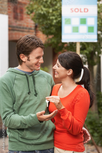 Woman giving new house key to partner