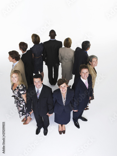 Group of Businesspeople Holding Hands, looking out
