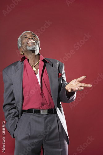 Man Laughing and Gesturing