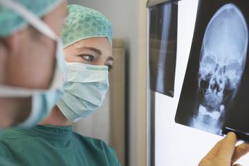 Radiologists Examining X-Ray of skull, close up