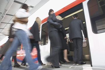 Business Commuters Getting on Train, motion blur, low angle view