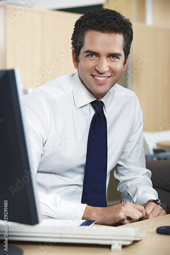 Smiling businessman in office, portrait