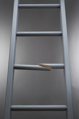 Ladder with one step broken
