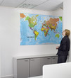 Businesswoman studying world map in office