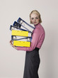 Female office worker carrying empty binders, on white background