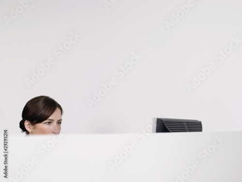 Female office worker in office cubicle