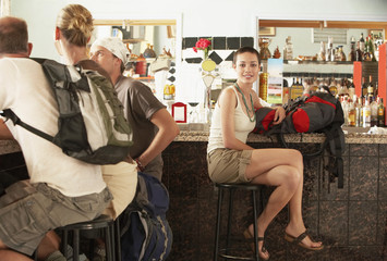Group of hikers sitting in bar