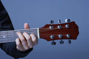 Hand Playing on Neck of Guitar, detail, close-up