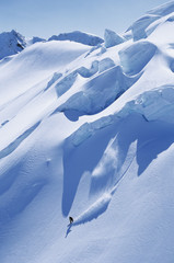 Solitary snowboarder on steep slope
