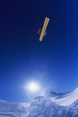 Skier jumping, against blue sky