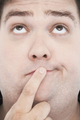 Overweight Man with Finger on Mouth, portrait, close up