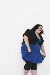 Overweight Woman laughing while curtseying
