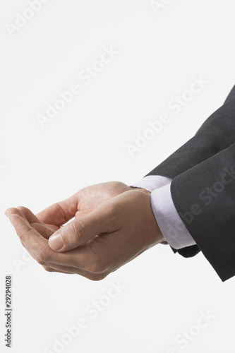 Businessman Cupping His Hands, close-up on hands