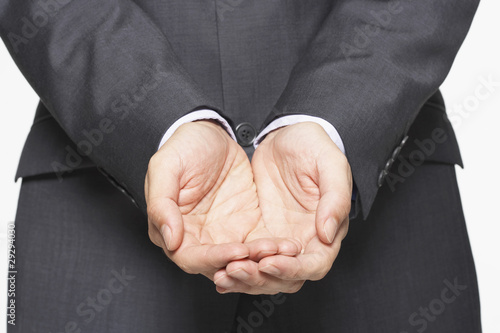 Businessman Cupping His Hands, close-up on hands, mid section