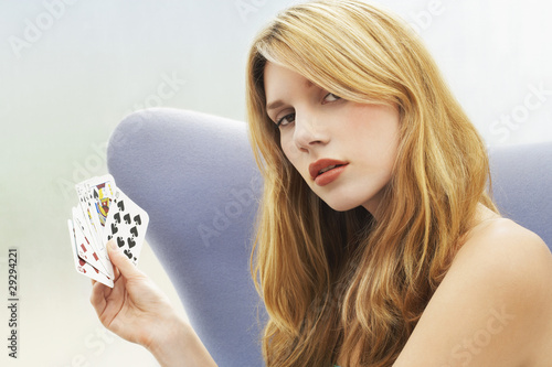 Woman sitting Playing Cards, portrait
