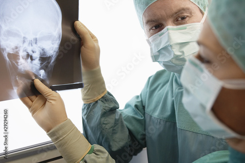 Radiologists Examining X-Ray of skull