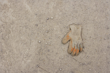 Work glove lying in the dirt