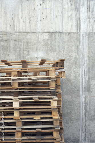 Stack of pallets against concrete wall