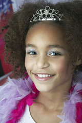 Young Girl in make-up, tiara and boa Playing Dress Up