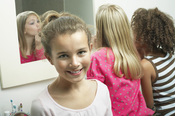Young girl in bathroom with friends