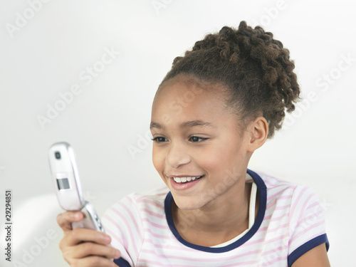 Young Girl using Cell Phone
