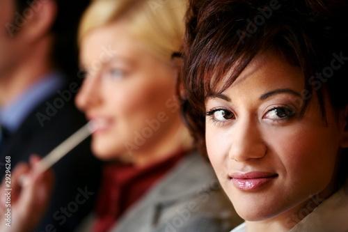Portrait of young brunette businesswoman