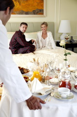Mature couple having room service breakfast