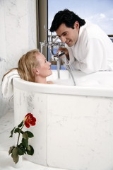 Couple enjoying bubble bath