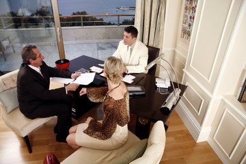 Three business people working in a hotel room