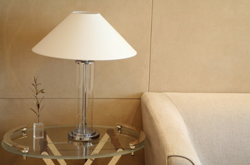 Armchair with sidetable and lamp