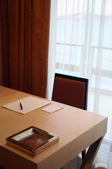 Desk with writing pad and pen