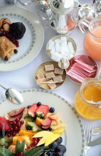 Breakfast table with fruit;pastries;juices