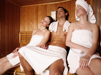 A man and two young women relaxing at a spa  together