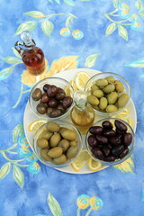 Assortment of olives with oil and vinegar