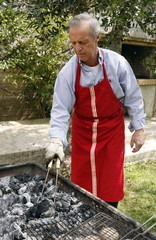 Mature man cooking food at a barbecue