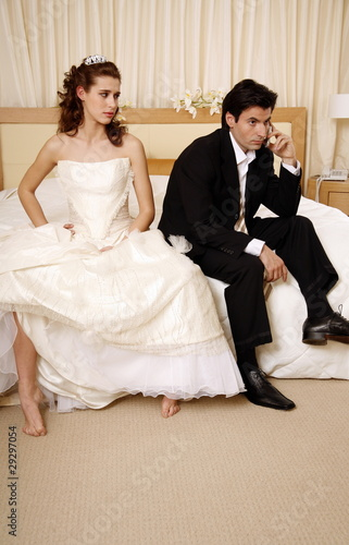 Bride waiting for groom to get off the phone