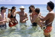 Group of friends in water having fun