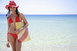 Young woman with bikini;hat;and beach bag