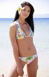 Fototapety Young woman in bikini on beach
