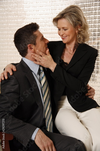 Man and woman sitting in hotel lobby