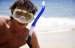 Man on beach with scuba mask